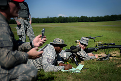 (Right) Senior Airman Jennifer Gamez, 19th Security Forces Squadron installation entry controller, prepares to fire an M24 sniper weapon system at a range on Camp Robinson, Ark., June 6, 2018. Gamez waited for her spotter to provide her with the best shot on target for her advanced designated marksman qualification. (U.S. Air Force photo by Airman 1st Class Kristine M. Gruwell)