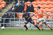 Bradford City striker Kai Brunker (21) and Blackpool defender Curtis Tilt (16) during the EFL Sky Bet League 1 match between Blackpool and Bradford City at Bloomfield Road, Blackpool, England on 7 April 2018. Picture by Craig Galloway.