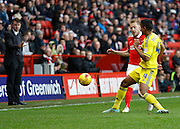 Nottingham Forest defender Michael Mancienne  gets a tackle in on Charlton Athletic defender Chris Solly during the Sky Bet Championship match between Charlton Athletic and Nottingham Forest at The Valley, London, England on 2 January 2016. Photo by Andy Walter.