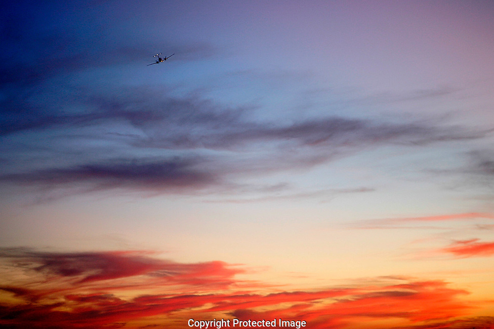 I plane takes at sunset from Clovis Municipal Airport.
