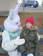 Abigail Foley (R), 7 years old, shares a laugh with the Easter Bunny (portrayed by Kim Coffin) after the Easter Egg Hunt Saturday March 28, 2015 at the Bristol Township Musical Complex football field in Bristol Township, Pennsylvania. About 250 children participated in the hunt to find about 3,000 Easter Eggs. (Photo by William Thomas Cain/Cain Images)