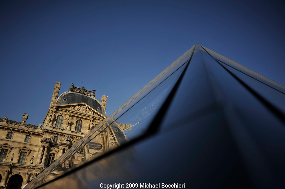 PARIS, FRANCE - September 07:  General view of The Musée du Louvre or officially the Grand Louvre on September 07, 2009 in PARIS, France. The Louvre - is the largest national museum of France, the most visited museum in the world, and a historic monument. It is a central landmark of Paris, located on the Right Bank of the Seine in the 1st arrondissement (neighbourhood). Nearly 35,000 objects from prehistory to the 19th century are exhibited over an area of 60,600 square metres (652,300 square feet). An important settlement for more than two millennia, Paris is today one of the world's leading business and cultural centres, and its influence in politics, education, entertainment, media, fashion, science and the arts all contribute to its status as one of the world's major global cities.  (Photo by Michael Bocchieri/Bocchieri Archive)