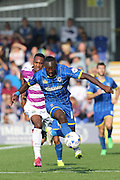Ade Azeez of AFC Wimbledon strides ahead during the Sky Bet League 2 match between AFC Wimbledon and Barnet at the Cherry Red Records Stadium, Kingston, England on 3 October 2015. Photo by Stuart Butcher.