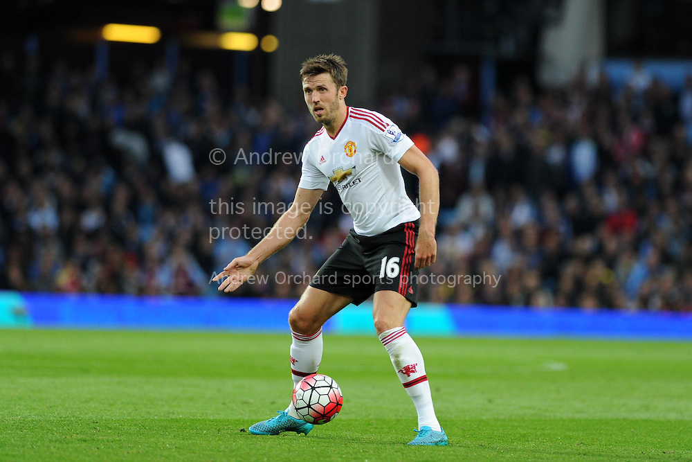 Michael Carrick of Manchester Utd in action. Barclays Premier League match, Aston Villa v Manchester Utd at Villa Park in Birmingham, Midlands on Friday 14th August  2015.<br /> pic by Andrew Orchard, Andrew Orchard sports photography.
