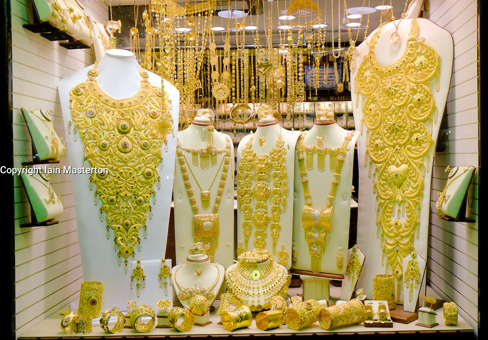 Gold jewellery for sale in shop in Gold Souk in Deira district of Dubai United Arab Emirates