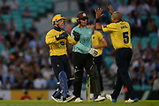 Tim Ambrose and Jeetan Patel of Birmingham Bears celebrate the wicket of Jason Roy of Surrey during the NatWest T20 Blast South Group match between Surrey County Cricket Club and Warwickshire County Cricket Club at the Kia Oval, Kennington, United Kingdom on 25 August 2017. Photo by Dave Vokes.