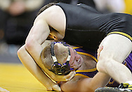 December 8, 2011: Iowa Hawkeyes Mike Evans pins Northern Iowa Panthers Riley Banach in the 165 pound bout of the NCAA wrestling dual between the Northern Iowa Panthers and the Iowa Hawkeyes at Carver-Hawkeye Arena in Iowa CIty, Iowa on Thursday, December 8, 2011. Evans defeated Banach with a fall in 1:10 and Iowa defeated Northern Iowa 38-4.