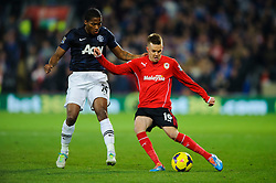 Cardiff Midfielder Craig Noone (ENG) is challenged by Man Utd Midfielder Luis Antonio Valencia (ECU) during the second half of the match - Photo mandatory by-line: Rogan Thomson/JMP - Tel: Mobile: 07966 386802 - 24/11/2013 - SPORT - FOOTBALL - Cardiff City Stadium - Cardiff City v Manchester United - Barclays Premier League.