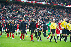 MANCHESTER, ENGLAND - Sunday, January 13, 2013: Liverpool's captain Steven Gerrard leads his side out to face Manchester United during the Premiership match at Old Trafford. (Pic by David Rawcliffe/Propaganda)