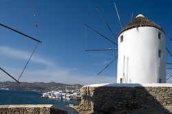 "Windmills of Mykonos with ""Little Venice"" in the distance"
