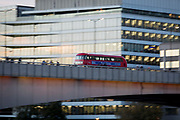 A blurred rush-hour London bus crosses London Bridge at the beginning of the evening rush-hour, on 2nd November 2018, in London, England.