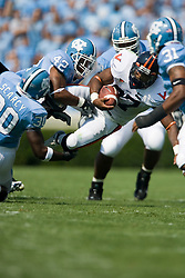 Virginia running back Cedric Peerman (37) is tackled by North Carolina cornerback Charles Brown (42), North Carolina safety Bryan Dixon (30) and North Carolina safety Trimane Goddard (31).  The North Carolina Tar Heels football team faced the Virginia Cavaliers at Kenan Memorial Stadium in Chapel Hill, NC on September 15, 2007.  UVA defeated UNC 22-20.