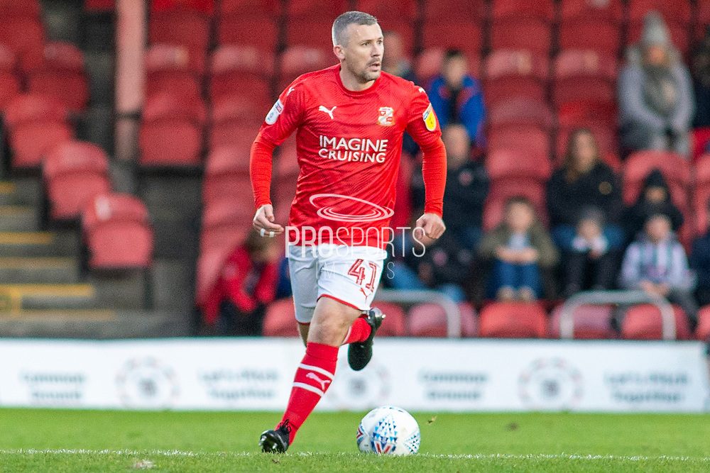 Paul Caddis of Swindon Town during the EFL Sky Bet League 2 match between Grimsby Town FC and Swindon Town at Blundell Park, Grimsby, United Kingdom on 7 December 2019.