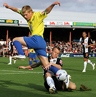 Photo: Paul Thomas.<br /> Grimsby Town v Hereford United. Coca Cola League 2. 08/10/2006.<br /> <br /> Rickey Ravenhill (R) of Grimsby jumps in to tackle Alan Connell.