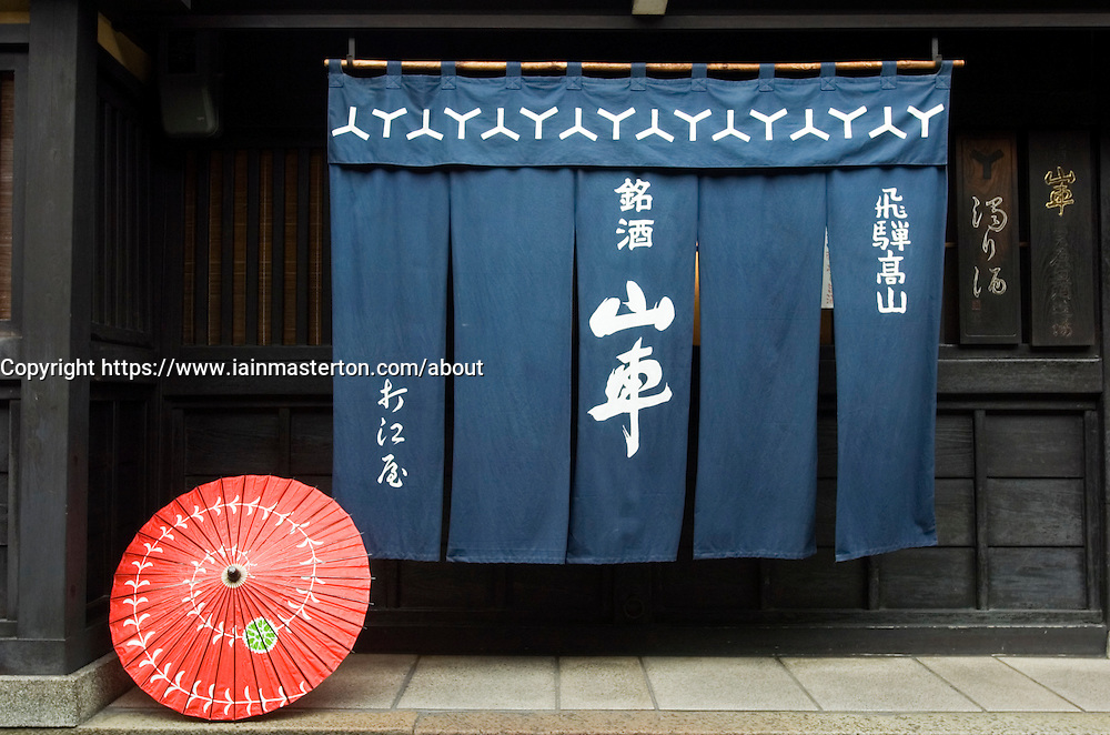 Entrance to traditional shop with ornate curtains in historic town of Takayama in Japan