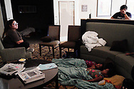 Children sleep in a hotel lobby waiting out Hurricane Harvey in  Victoria, Texas August 26, 2017. REUTERS/Rick Wilking