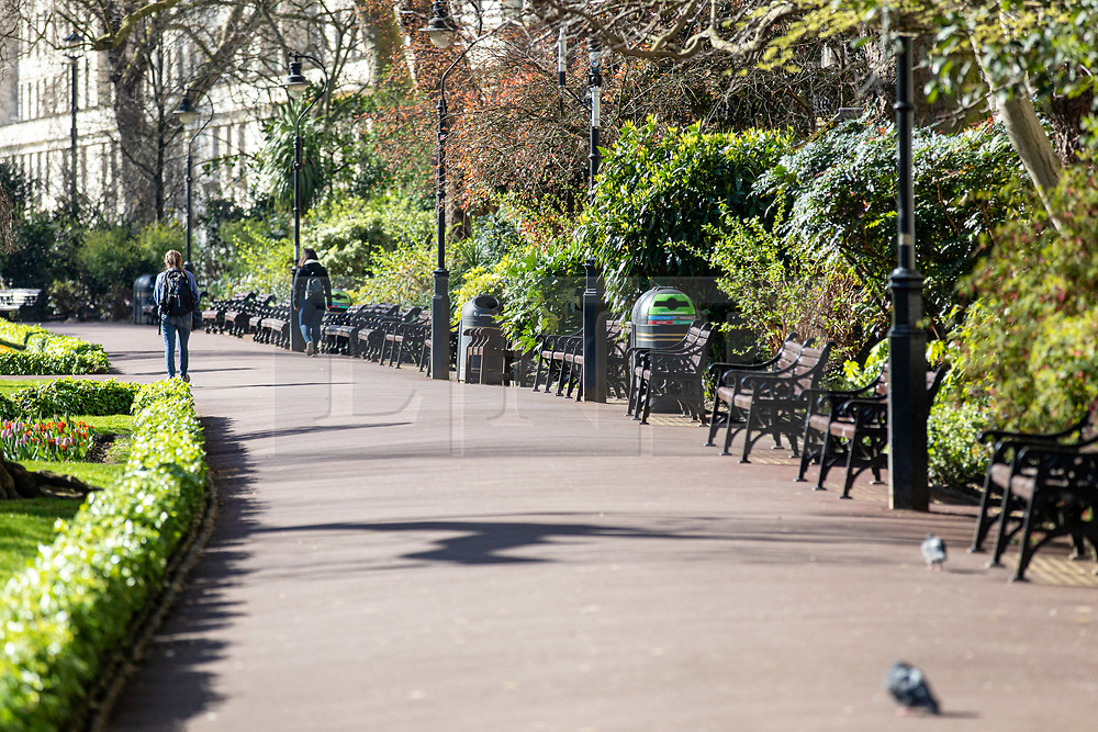 © Licensed to London News Pictures. 23/03/2020. London, UK. Empty benches on a sunny morning in Victoria Embankment Gardens as people continue to avoid central London. The government has refused to rule out tougher measures to enforce social distancing if people do not begin following the health advice. Photo credit: Rob Pinney/LNP