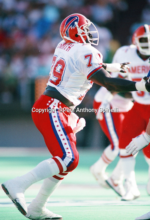 Buffalo Bills defensive end Bruce Smith (79) chases the action during the 1990 NFL Pro Bowl between the National Football Conference and the American Football Conference on Feb. 4, 1990 in Honolulu. The NFC won the game 27-21. (©Paul Anthony Spinelli)