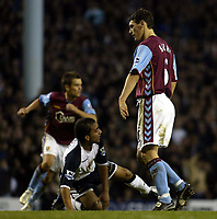 Photo: Chris Ratcliffe.<br />Tottenham Hotspur v Aston Villa. The Barclays Premiership. 21/01/2006.<br />Gareth Barry (R) knows he is going to be sent off after bringing down Aaron Lennon.