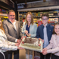 New Owners Gerry and Lorraine Gerraghty with their children Caoimhe,, Eoin, and Tara cutting the cake at the official opening of Gerraghty's Spar in Turnpike