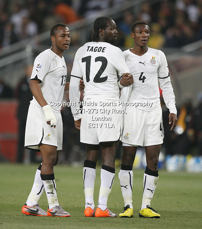 23/06/2010 - 2010 FIFA World Cup - Ghana vs. Germany - Prince Tagoe of Ghana (C) forms a defensive wall with teammates Andre Ayew (L) and John Pantsil (R) - Photo: Simon Stacpoole / Offside.