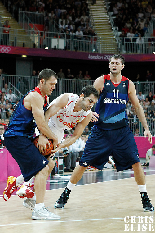 02 August 2012: Great Britain Nate Reinking vies for the ball with Jose Calderon during 79-78 Team Spain victory over Team Great Britain, during the men's basketball preliminary, at the Basketball Arena, in London, Great Britain.