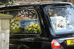 Pictured is the coffin with a portrait of Peaches Geldof and her family.<br /> Friends and family arrive at St Mary Magdalene and St Lawrence church in the village of Davington, Kent, to the funeral of Peaches Geldof.<br /> Monday, 21st April 2014. Picture by Ben Stevens / i-Images