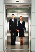 Businesspeople Side by Side in Elevator portrait front view