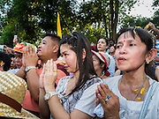 20 SEPTEMBER 2015 - SARIKA, NAKHON NAYOK, THAILAND: People pray at the river during the culmination of the Ganesh festival at Shri Utthayan Ganesha Temple in Sarika, Nakhon Nayok. Ganesh Chaturthi, also known as Vinayaka Chaturthi, is a Hindu festival dedicated to Lord Ganesh. Ganesh is the patron of arts and sciences, the deity of intellect and wisdom -- identified by his elephant head. The holiday is celebrated for 10 days. Wat Utthaya Ganesh in Nakhon Nayok province, is a Buddhist temple that venerates Ganesh, who is popular with Thai Buddhists. The temple draws both Buddhists and Hindus and celebrates the Ganesh holiday a week ahead of most other places.    PHOTO BY JACK KURTZ    PHOTO BY JACK KURTZ