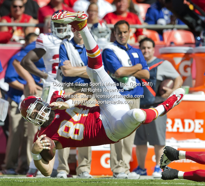 September 29, 2013 - Kansas City, Missouri, U.S. - Kansas City Chiefs tight end SEAN MCGRATH (84) flies through the air after getting tackled by New York Giants cornerback Aaron Ross (31) during the third quarter at Arrowhead Stadium. The Chiefs won, 31-7