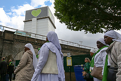 © Licensed to London News Pictures. 14/06/2019. London, UK.  Nuns take part in a silent procession with the Grenfell Tower in the background to commemorate the second anniversary of the Grenfell Tower fire. On 14 June 2017, just before 1:00 am a fire broke out in the kitchen of the fourth floor flat at the 24-storey residential tower block in North Kensington, West London, which took the lives of 72 people. More than 70 others were injured and 223 people escaped. Photo credit: Dinendra Haria/LNP