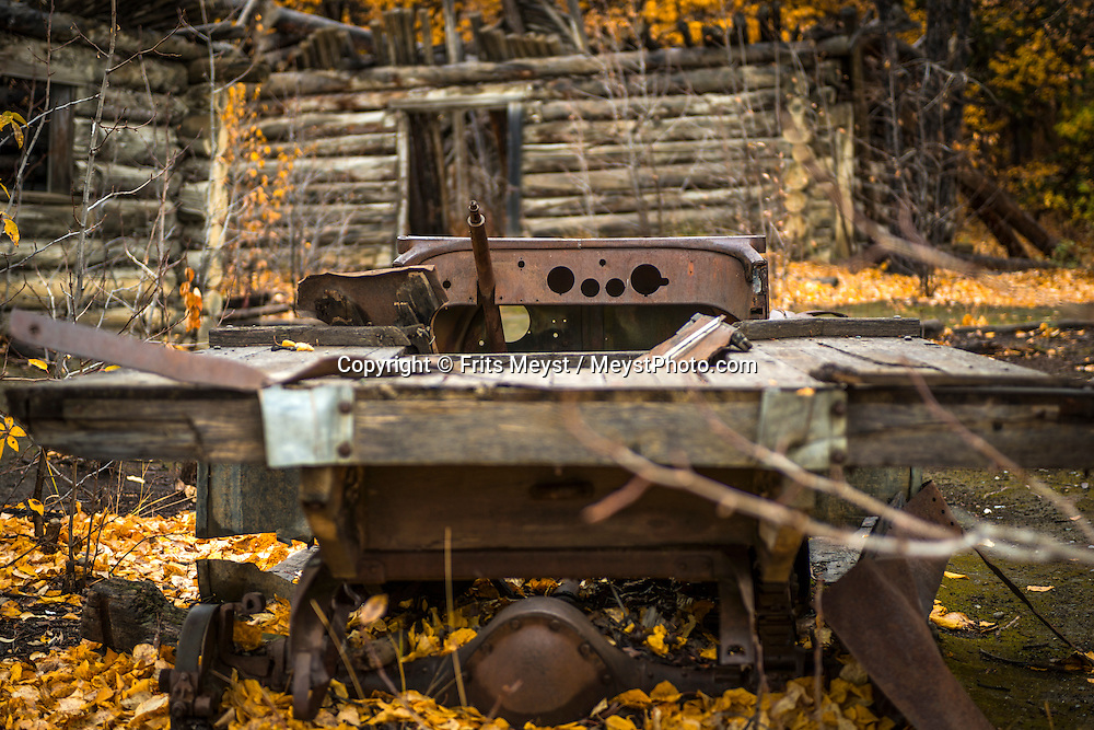 Yukon Territory, Canada, September 2014. old log cabins and cars of Silver City. Gold Rust! Remnants of the Klondyke Gold Rush Left in the Yukon Landscape. The Yukon Territory received world fame during the Klondike Gold Rush in 1898.  Photo by Frits Meyst / MeystPhoto.com