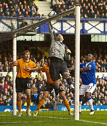 LIVERPOOL, ENGLAND - Sunday, March 7, 2010: Hull City's goalkeeper Boaz Myhill can't prevent Everton's Mikel Arteta scoring his hat-trick goal during the Premiership match at Goodison Park. (Photo by David Rawcliffe/Propaganda)