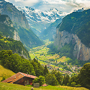 The impressive Lauterbrunnen valley with many of the clear glacial streams and waterfalls seen from the cog-railway en route up to the car-free mountain village of Wengen (1274m / 4180ft) in Switzerland