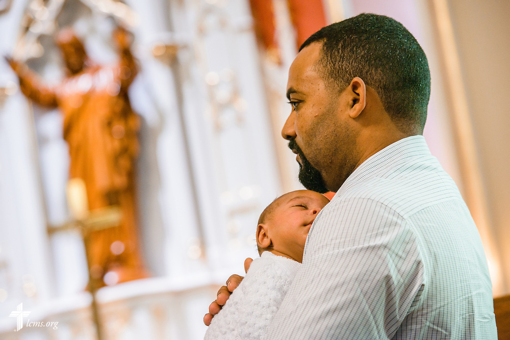 Infant Ian Terrero-Toribio snuggles before his baptism Saturday, Oct. 1, 2016, at St. John's Lutheran Church in Beardstown, Ill. LCMS Communications/Erik M. Lunsford
