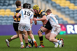 Alfred Mawdsley of Wasps U18 is tackled by Joe Snow (capt) of Exeter Chiefs U18 - Rogan Thomson/JMP - 16/02/2017 - RUGBY UNION - Sixways Stadium - Worcester, England - Wasps U18 v Exeter Chiefs U18 - Premiership Rugby Under 18 Academy Finals Day 3rd Place Play-Off.