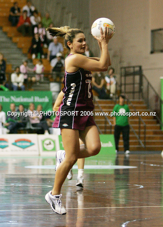 Force centre Temepara George looks to pass during the 2006 National Bank Cup round 4 netball game between the Force and the Sting held at North Shore Events Centre, Auckland, New Zealand on Sunday 21 May 2006. Photo: Tim Hales/PHOTOSPORT