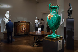 © Licensed to London News Pictures. 06/07/2015. London, UK.  A Malachite vase, presented by Emperor Nicholas I of Russia to Domenico Antonio Lo Faso Pietrasanta, Duke of Serradifalco (est. £250k to £350k) stands out amongst other artworks at the preview of Old Masters, British Paintings and Masterworks from the collection of Castle Howard at Sotheby's ahead of the auction on July 8. Photo credit : Stephen Chung/LNP
