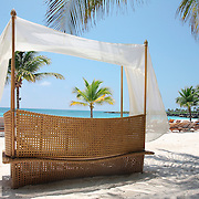 Cap Cana, Dominican Republic - April 12: A canopied bench sits nexton the beach at the Caleton Beach Club in Cap Cana, Dominican Republic, April 12, 2007.