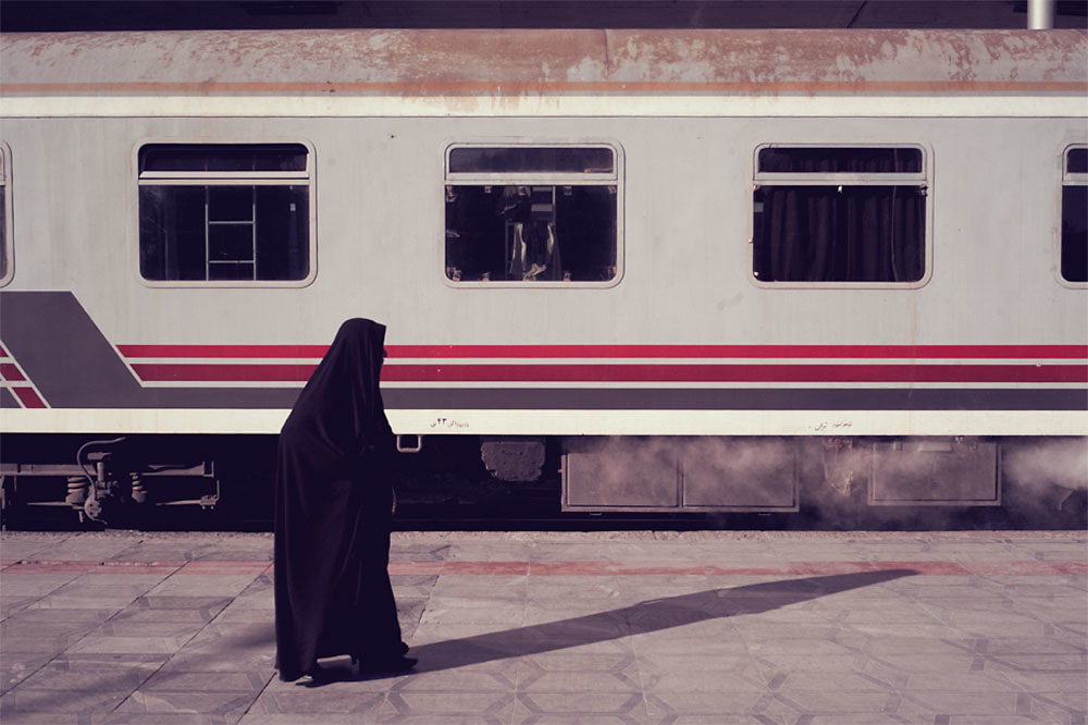 A women walks along the train platform at Tabriz train station during the the 3 day journey from Tehran to Damascus  East Azerbaijan Province, Iran on the 15th Nov, 2007.