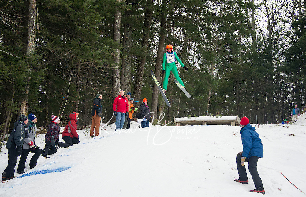 Cameron Summerton U14 from Lebanon Outing Club takes off from the K20 hill during Gunstock Nordic Associations ski jump meet Saturday morning.  (Karen Bobotas/for the Laconia Daily Sun)