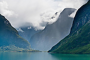 The lake Lovatnet, near Loen in Stryn municipality, in Sogn og Fjordane county, Norway, lies beneath mountain Skåla and is fed by Jostedalsbreen and Tindefjellbreen glaciers.