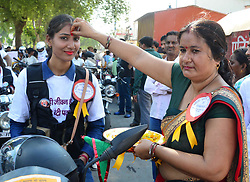 June 26, 2017 - Allahabad, Uttar Pradesh, India - Allahabad: A women greets Women bikers as they take part in awareness against female foeticide and propagate the government's women helpline number 181, in Allahabad on 26 june 2017. (Credit Image: © Prabhat Kumar Verma via ZUMA Wire)