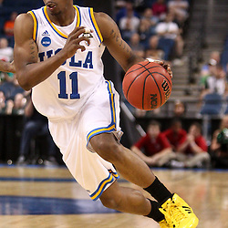 Mar 17, 2011; Tampa, FL, USA; UCLA Bruins guard Lazeric Jones (11) during the second half of the second round of the 2011 NCAA men's basketball tournament against the Michigan State Spartans at the St. Pete Times Forum. UCLA defeated Michigan State 78-76.  Mandatory Credit: Derick E. Hingle