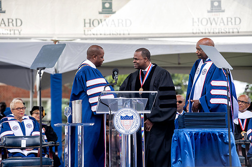 President Wayne A.I. Frederick, Kasim Reed, and Chairman of the Board Stacey Mobley on stage at Commencement.