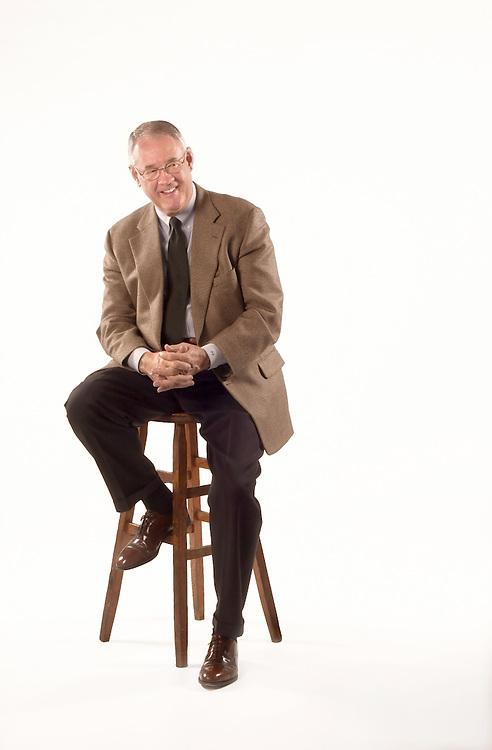 16307Full body shot Dr. Glidden speaking in front of White Backdrop for Ohio Today Cover 2/23/04