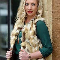 Fur vest, $68; blouse, $46; bronze shimmer pencil skirt, $32; necklace, $18; earrings, $12