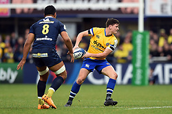 Freddie Burns of Bath Rugby looks to pass the ball - Mandatory byline: Patrick Khachfe/JMP - 07966 386802 - 15/12/2019 - RUGBY UNION - Stade Marcel-Michelin - Clermont-Ferrand, France - Clermont Auvergne v Bath Rugby - Heineken Champions Cup