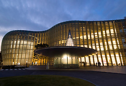 Evening view of modern glass walled Tokyo National Arts Center in Roppongi in central Tokyo Japan