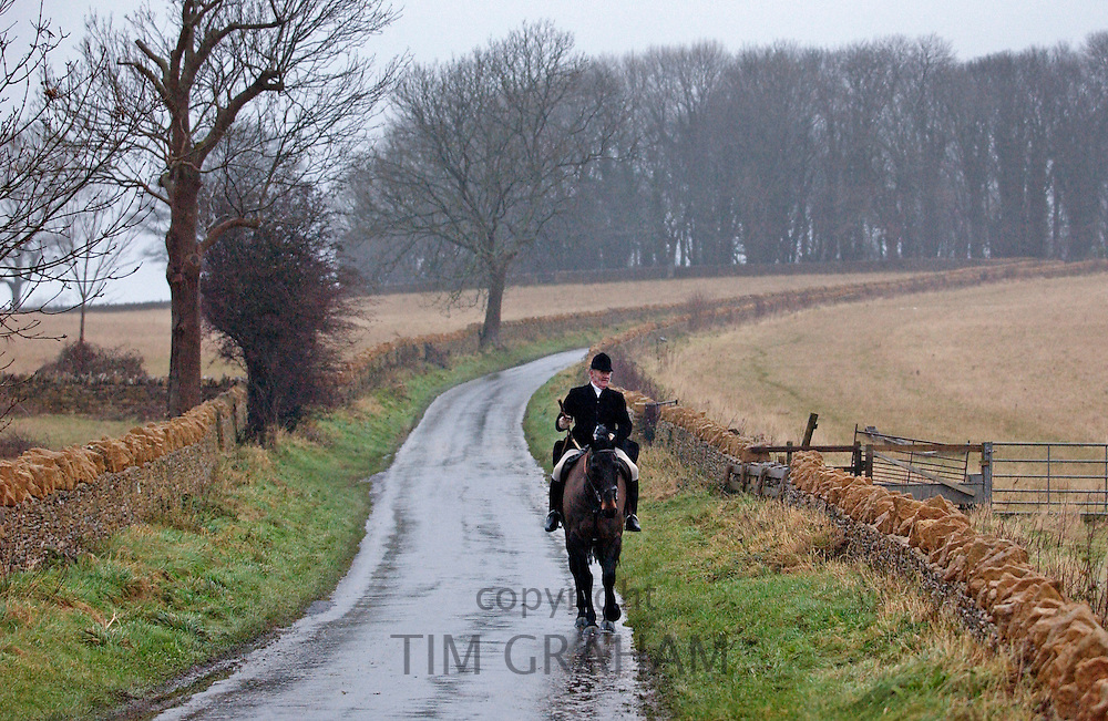 A lone huntsman returns home after taking part in the Heythrop New Year's Day Hunt, Oxfordshire